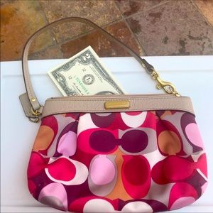 Medium size Coach wristlet with a free $2 bill!